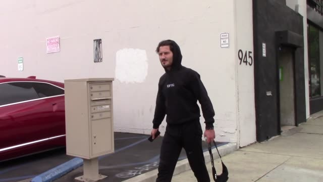 valentin chmerkovskiy greets kel mitchell outside the dwts rehearsal studio in hollywood in celebrity sightings in los angeles on - dancing with the stars stock videos & royalty-free footage