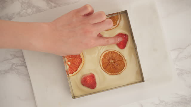 valentine day chocolate - hand decorating chocolate in mold - orange stock videos & royalty-free footage