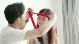 Valentine surprise:Thai man trying make head wear to girlfriend for Valentine and birthday celebration after he gave the gift box to her