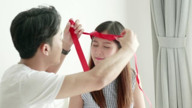 valentine surprise:thai man trying make head wear to girlfriend for valentine and birthday celebration after he gave the gift box to her - headwear stock videos & royalty-free footage