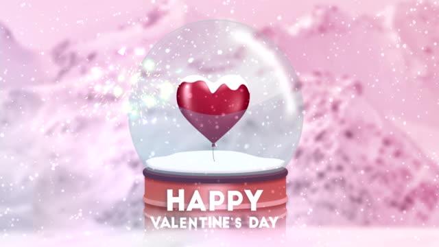 stockvideo's en b-roll-footage met aftelkalender voor valentijnsdag in een sneeuwbol met deeltje effect - star shape