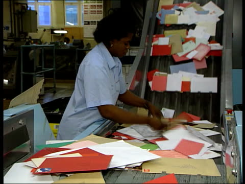 valentine's day retail boom itn london mount pleasant sorting office int woman sorting mail as more along on conveyor beside ms letters along... - valentines day stock videos & royalty-free footage