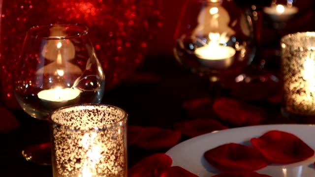 valentine's day romance with red heart, candles, and rose petals. - votive candle stock videos and b-roll footage