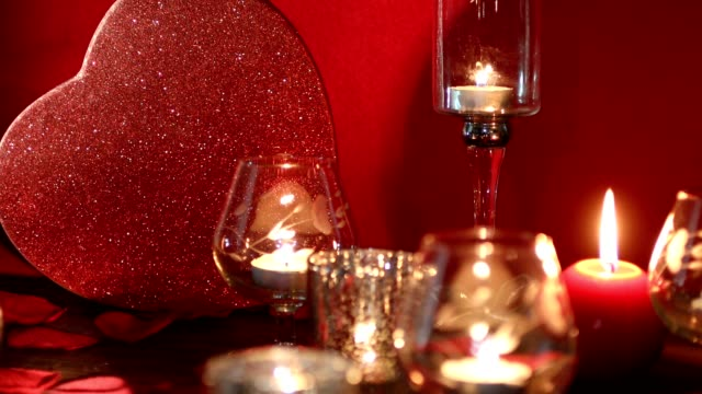 valentine's day romance with red heart, flickering candles, and rose petals. - rose petal stock videos and b-roll footage