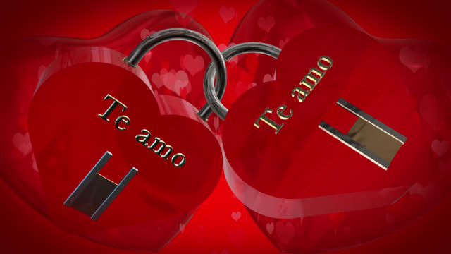 Valentine's Day with two heart shaped red padlocks with the Spanish phrase Te amo, I love you, two beating red 3D hearts and moving heart shaped particles are in the background