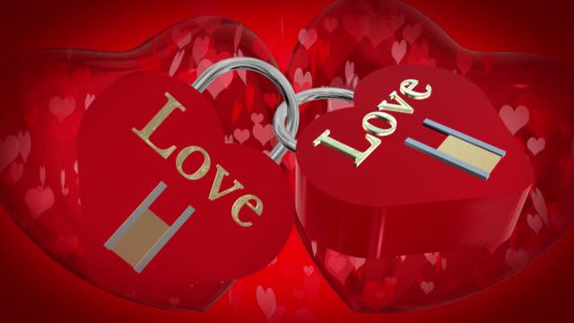 バレンタインの日に 2 つの心と形愛という言葉で赤い南京錠、2 赤い 3 d ハートを破って、ハート形の粒子がバック グラウンドに移動 - johnfscott点の映像素材/bロール