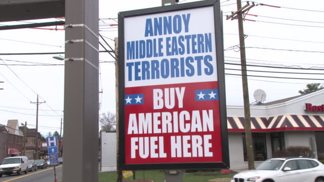 stockvideo's en b-roll-footage met valero gas station in emerson, nj proudly displays a controversial sign urging people to buy american gasoline / the sign suggests that by not buying... - patriotism