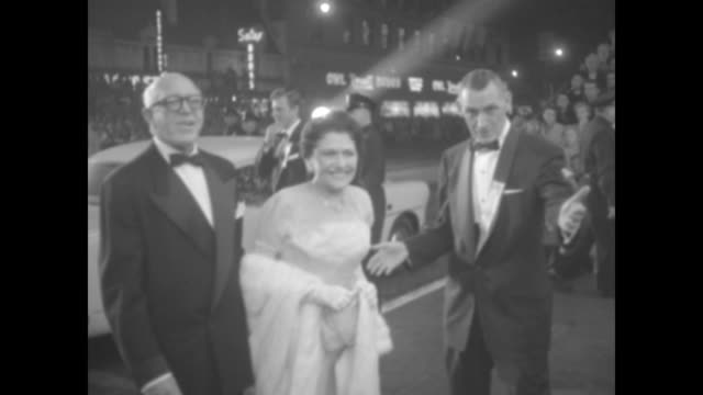 valet guides composer jimmy mchugh and gossip columnist louella parsons as they arrive for the premiere of a star is born in hollywood crowd seated... - columnist stock videos & royalty-free footage