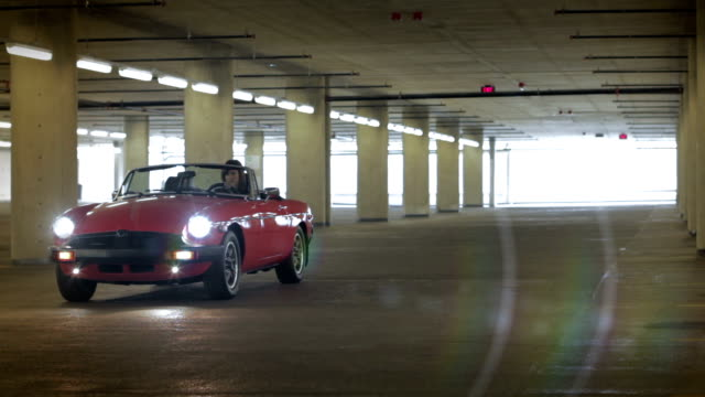 valet helps a beautiful starlet - car park stock videos & royalty-free footage