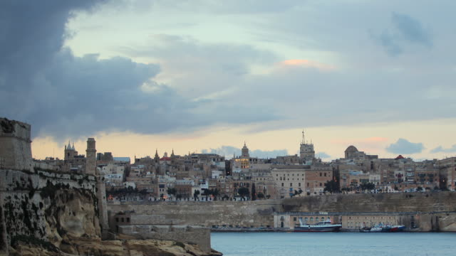 t/l ws valetta grand harbor, day to night transition / valletta, malta - valletta stock videos & royalty-free footage
