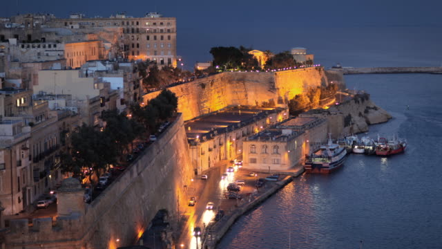 t/l ws ha valetta old town castille curtain, day to night transition / valletta, malta - valletta stock videos & royalty-free footage