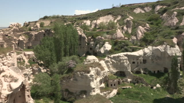 valley and houses, cappadocia, turkey - cliff dwelling stock videos & royalty-free footage