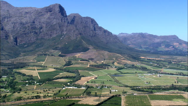valley leading to franschhoek  - aerial view - western cape,  cape winelands district municipality,  stellenbosch,  south africa - stellenbosch stock videos and b-roll footage