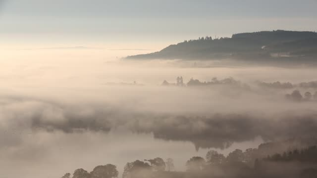 valley mist over lake windermere from todd crag in the lake district, uk at dawn. - english lake district stock videos and b-roll footage