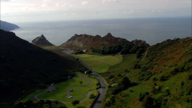 valley of rocks by lynton  - aerial view - england, devon, north devon district, united kingdom - devon stock videos & royalty-free footage