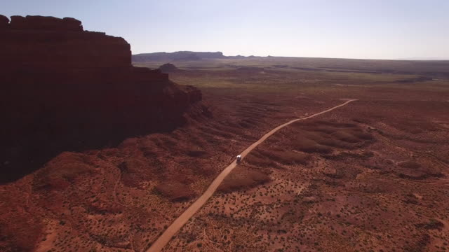 valley of the gods epic truck fly down wrap around, long, utah, aerial, 4k, 22of32, stock video sale - drone discoveries - drone aerial view - monument valley stock videos & royalty-free footage