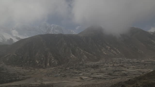valley view of mountains and clouds - khumbu stock videos and b-roll footage