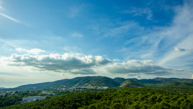 valley view with mountain and green forest trees, moving clouds on blue sky palma de mallorca castle majorca - palma stock videos & royalty-free footage