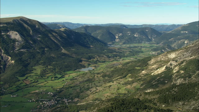 AERIAL Valley with village and lake/ Alpes-Maritimes, France