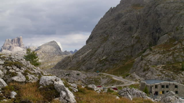 valparola pass in the dolomites mountains pan tl - traditionally austrian stock videos and b-roll footage