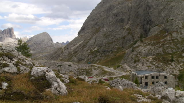 valparola pass in the dolomites mountains pan - traditionally austrian stock videos and b-roll footage