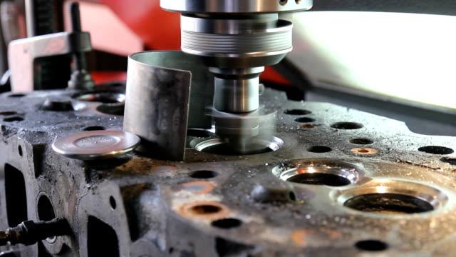 valve seat grinding machine. - machine valve stock videos and b-roll footage