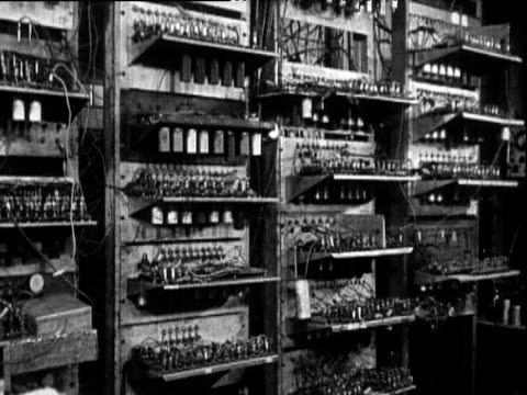 1500 valves of Manchester Baby engineers read and note processed data from cathode ray tube display Manchester Jun 49