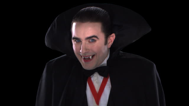 vampire close-up - this clip has an embedded alpha-channel - vampire stock videos and b-roll footage