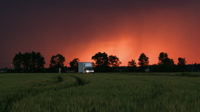 ds van driving along field of wheat at dusk - van vehicle stock videos and b-roll footage