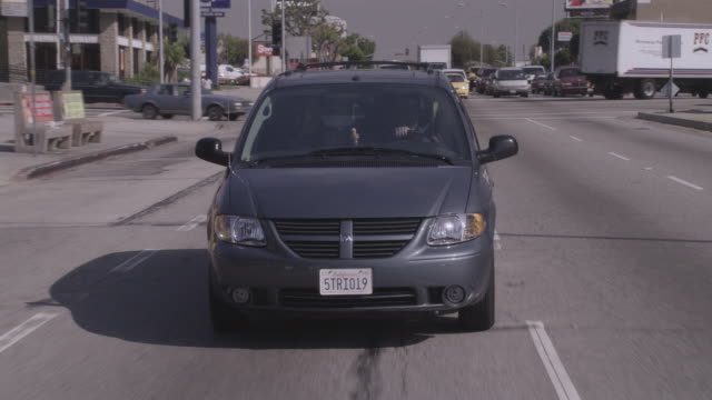 ds van driving down commercial business street / united states - front view stock videos & royalty-free footage