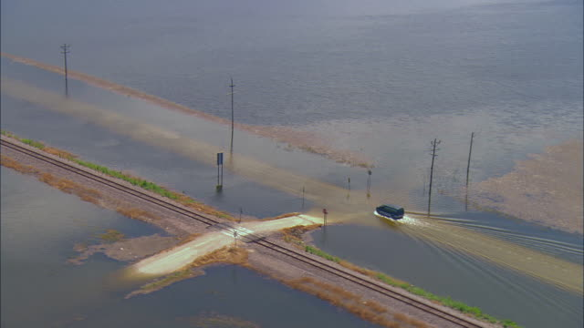 AERIAL Van driving on road in deep Mississippi River floodwaters/ Clarksville, Missouri
