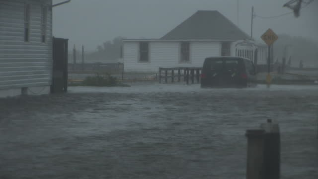 van is submerged in deep flood waters, as storm surge inundates the residential town of broad channel during hurricane irene's landfall in the new... - hurricane irene stock videos & royalty-free footage