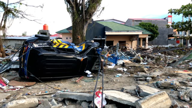 a van lying on its side after being hit by a tsunami on october 01 2018 in palu indonesia over 844 people have been confirmed dead after a tsunami... - lying on side stock videos & royalty-free footage