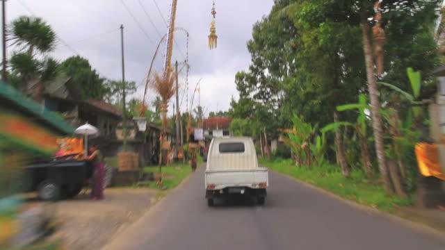 ms pov van moving along narrow balinese street / batur, bali, indonesia - indonesia street stock videos & royalty-free footage