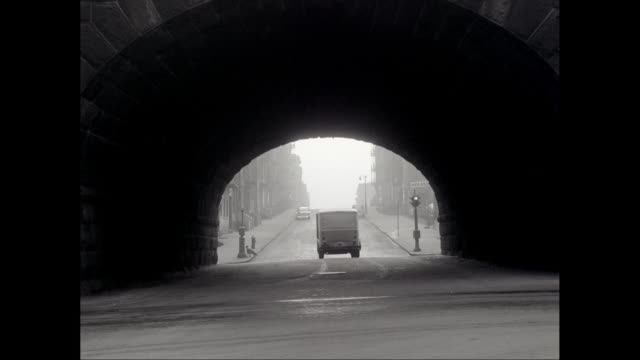 WS PAN Van on Park Avenue and passing under tunnel / New York City, New York State, United States