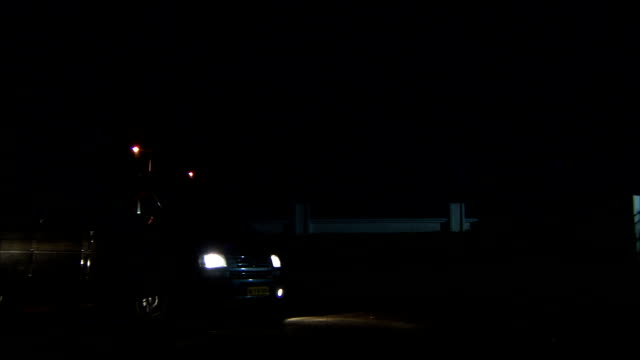 a van tows a vintage car at night time. available in hd - rimorchiare video stock e b–roll