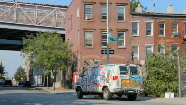 ts van with graffiti parked near rundown buildings under williamsburg bridge ramp / brooklyn, new york, usa - bad condition stock videos & royalty-free footage