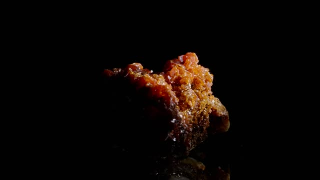 vanadinite crystals turning on black background - crystal stock videos & royalty-free footage