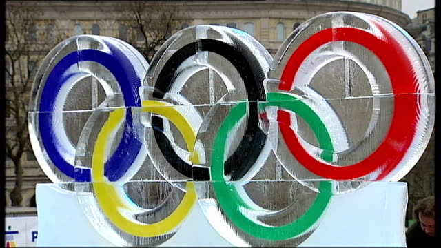 ice sculpture unveiled in trafalgar square england london trafalgar square ext general views of ice sculpture of olympic rings with message 'good... - olympic rings stock videos & royalty-free footage