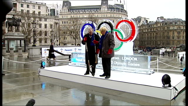 ice sculpture unveiled in trafalgar square boris johnson along / johnson and jim wright putting on red mittens with olympics rings logo and along to... - olympic rings stock videos & royalty-free footage