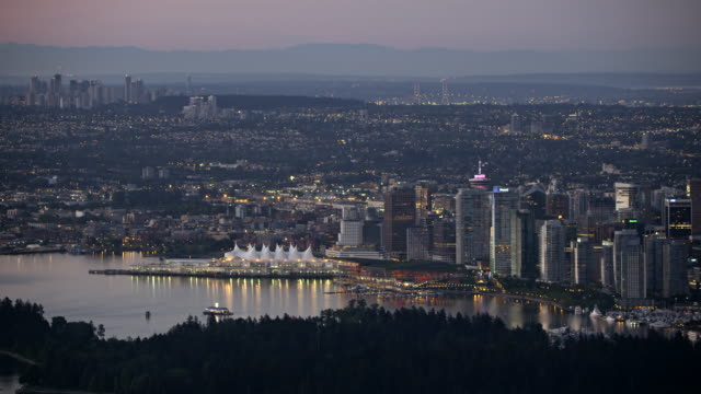 AERIAL Vancouver and the Lions Gate Bridge at dusk