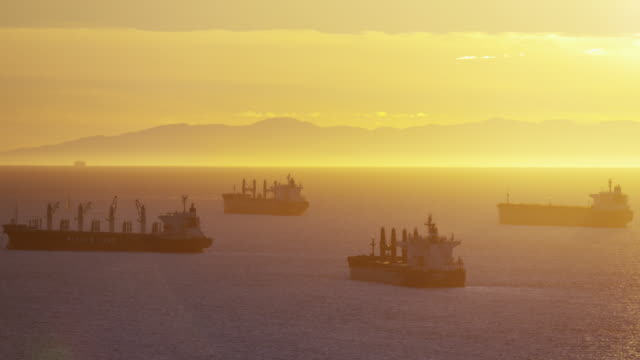 Vancouver coastal harbor with industrial shipping at sunrise