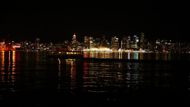 vancouver night skyline with high speed ferry passing by - ferry stock videos & royalty-free footage