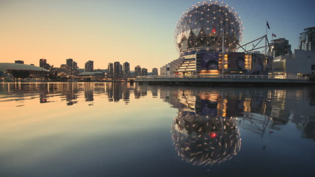 ws vancouver science center seen across water at dusk, british colombia, canada - real time stock videos & royalty-free footage