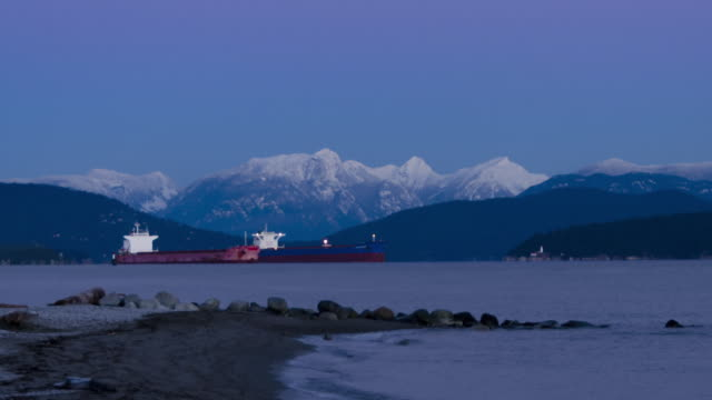 Vancouver Spanish Sunrise Timelapse zoom out with two anchored cargo ships in the distance.