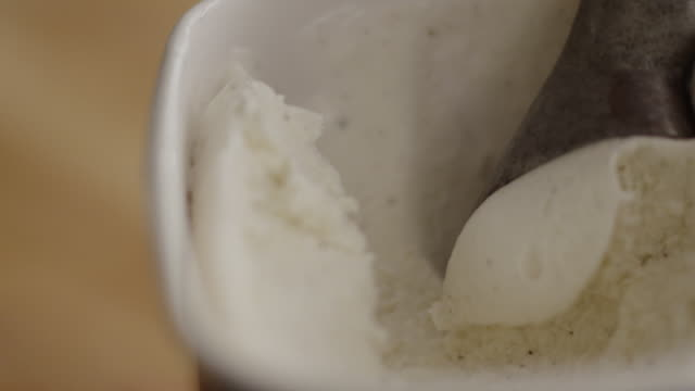 cu vanilla ice cream curled into a ball by scoop and lifted - serving scoop stock videos & royalty-free footage