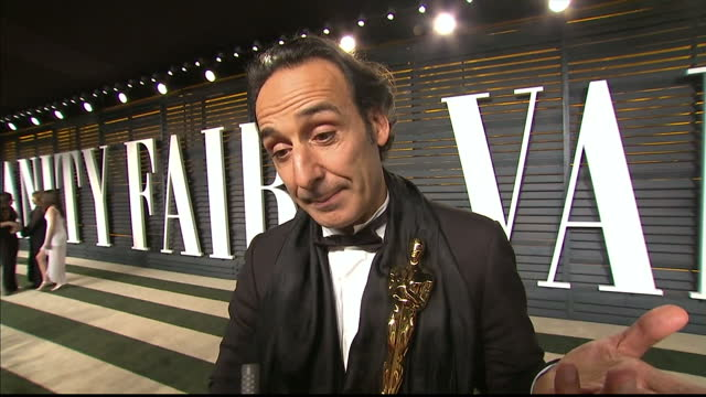 vanity fair oscars party arrivals at the wallis annenberg center for the performing arts in beverly hills exterior interview alexandre desplat... - festa post oscar di vanity fair video stock e b–roll