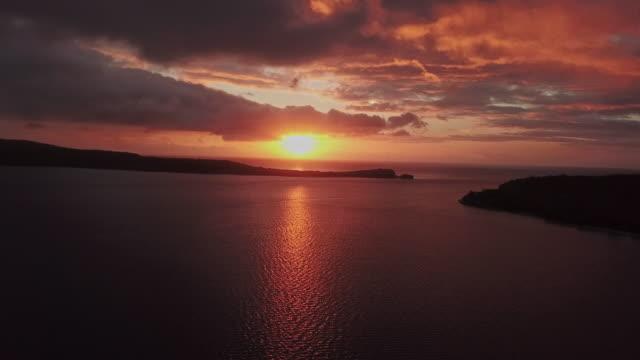 vanuatu sunset port villa drone aerial video 4k efate island - oceania stock videos & royalty-free footage