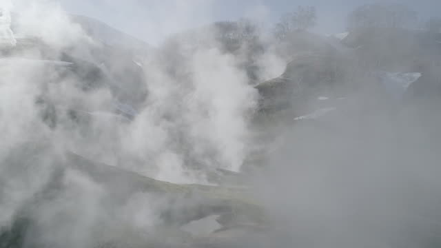 vapor rising from valley of geysers, kamchatka, russia - hot spring stock videos & royalty-free footage