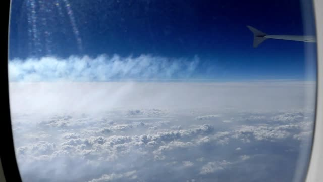 Vapor trail seen from airplane window